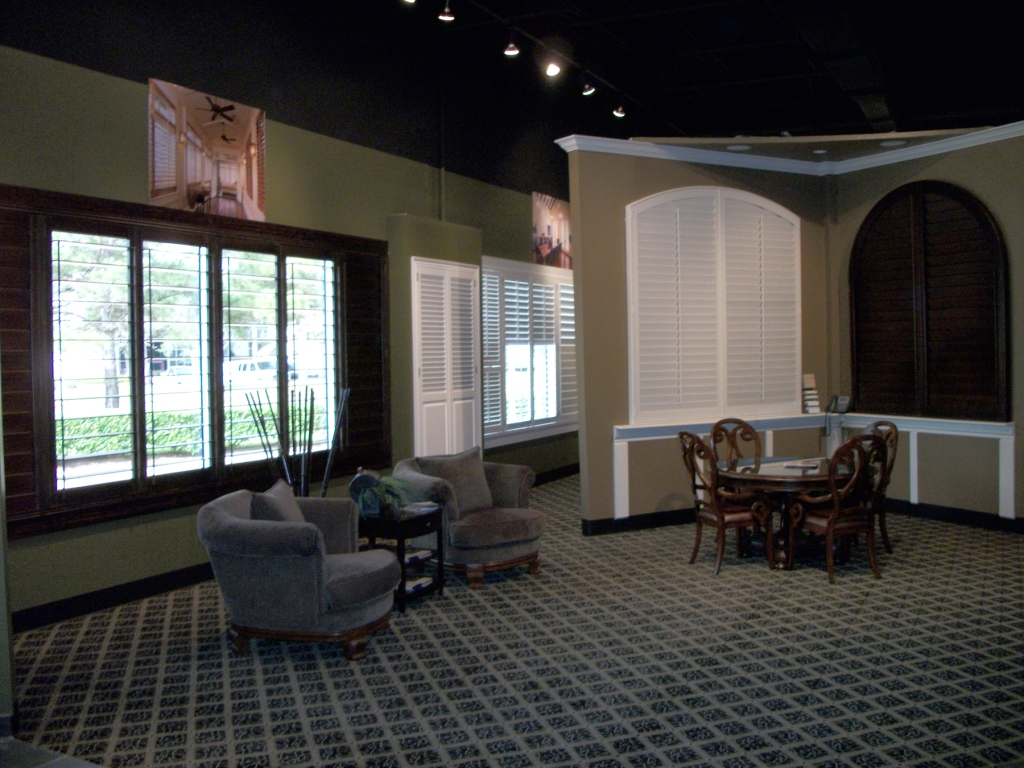 Big arched shutter displays in the Window Fashions of Texas showroom
